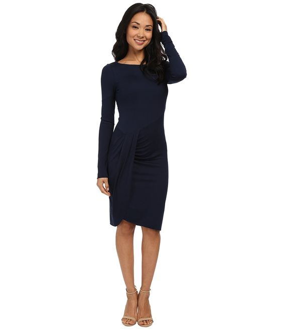A figure flattering dress fit for every cocktail occasion. ; Stretchy knit provides for a slim fit. ; Bateau neckline. ; Long sleeves. ; Draped faux wrap skirt layers at waistline. ; Asymmetrical tulip-style hemline. ; Unlined. ; Pullover design. ; 92% viscose, 8% spandex. ; Machine wash cold, line dry. ; Made in the U.S.A. and Imported. Measurements: ; Length: 39 in ; Product measurements were taken using size SM (US 4-6). Please note that measurements may vary by size.