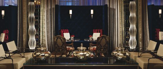 Sip cocktails on a cool blue settee under a fiery red chandelier in our contemporary lobby bar at The Ritz-Carlton, Atlanta.