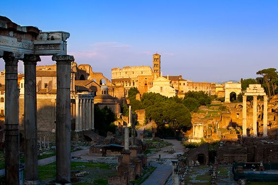 Ruins of the Roman Forum with Coliseum beyond, Rome Italy