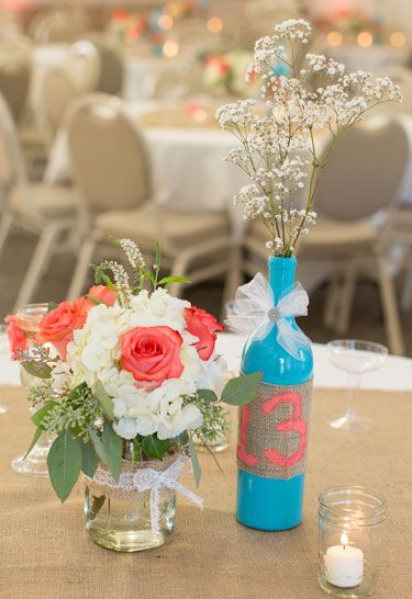 DIY Centerpieces Wine Bottles Table Number / Beautiful Coral and Aqua Theme / Summer Wedding in Crestmore Manor in Riverside, California / Coordination by Cloud 9 Wedding & Event Planning / Captured by Leanna Annunziato Photography / Please visit our website to view the full gallery / www.cloud9wedding.com