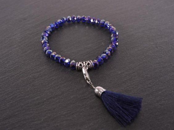 Bracelet élastique cristaux et pompon bleu