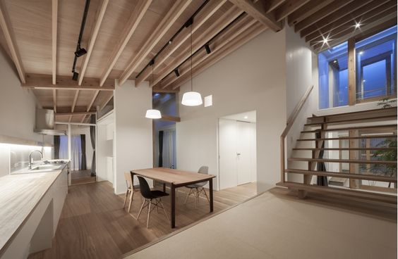 KW House is a minimalist house located in Anjo, Japan, designed by WORKCUBE. The two-story wooden residence is tucked between a commercial and residential lot. (4)