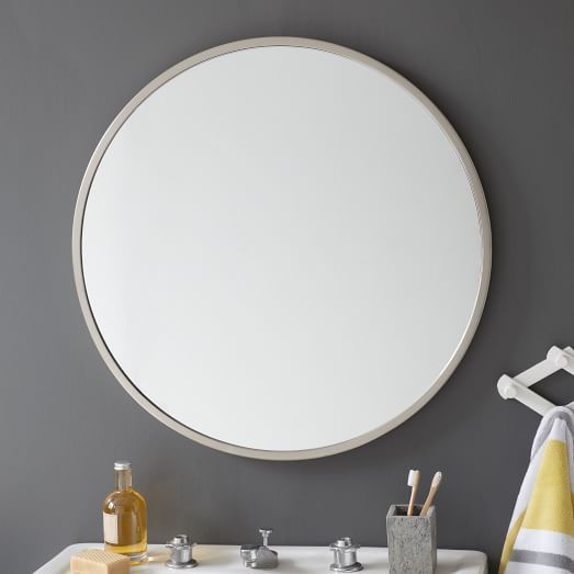 Downstairs bathroom round silver mirror grey paint Round framed mirror
