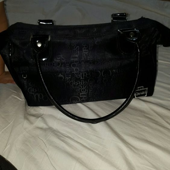 Caboodle doctor makeup bag Black caboodle doctor shaped makeup bag. Heavily used. Needs cleaning. There is a front and back zipper pocket. Inside the main compartment   are four pockets, Small mesh zipper pocket and on each side are four holders. Needs some TLC. caboodle Bags Cosmetic Bags & Cases