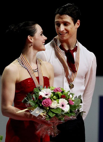Tessa Virtue and Scott Moir of Canada receive their gold medals - World Figure Skating Championships 2012 in Nice, France.