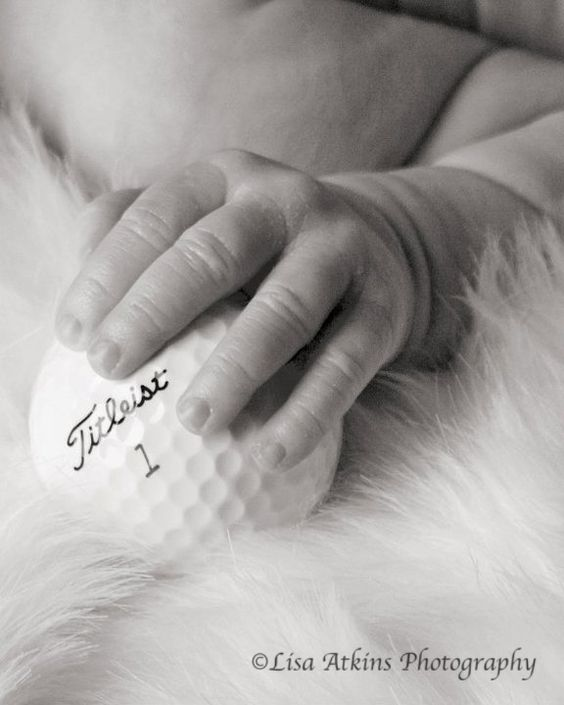 Baby hand with golf ball--@Alisa Brogden, i'm pretty sure this would be a great idea for little eli. =)