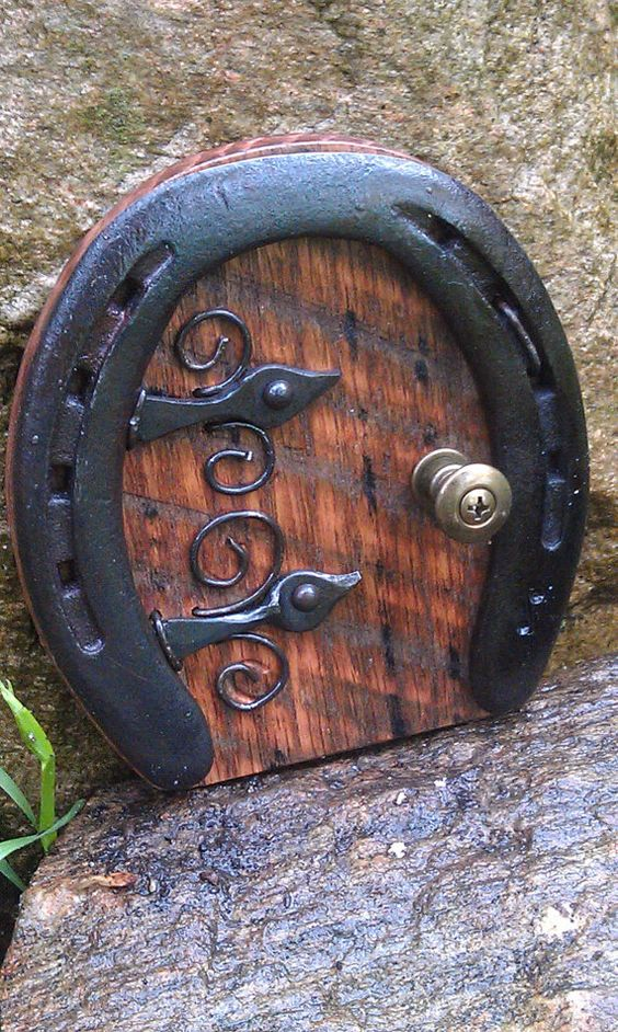 I make these doors from used horse shoes, hand forged hardware, and repurposed items...  5 inches tall and 4 3/4 inches wide.  All your wee folk will