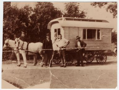 Three Gypsies pose in front of a horse-drawn caravan. - (Photo courtesy USHMM)