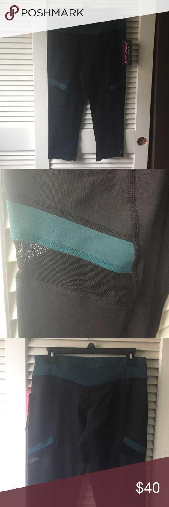 """Betsey Johnson performance pants Betsey Johnson performance workout pants. Capri length with mesh side piece on both outer thighs and on the lower inner bottom of pants. Black Teal (green) color with wide waist band and small back rear zipped pocket at center of back. Stretch fabric. Approx measurements length 29"""" waist without stretching 15.5"""" Betsey Johnson Pants Ankle & Cropped"""