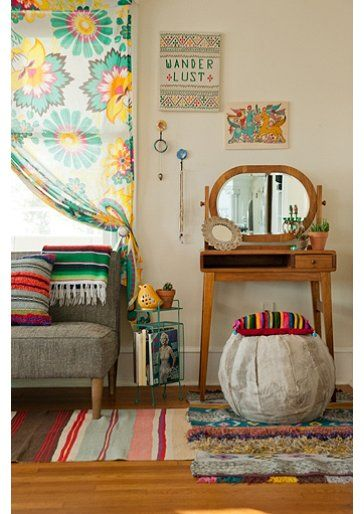 The small stand in turquoise, the yellow bird votive holder, the great sofa, colorful curtains-there is a lot to take from this Urban Outfitter's room.