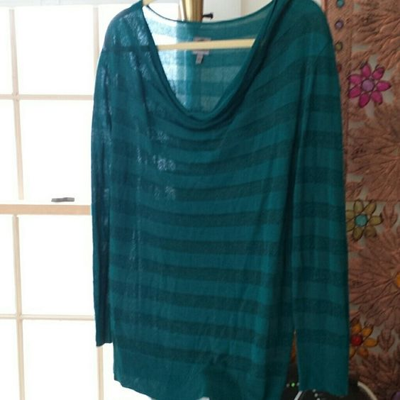 Queen collection lovely top It's a lovely cowl neck top comes from Queen Latifah collection it is long sleeve has a slight Sheerness to it dark green teal straight one stripe is shimmery Siri pretty never wore it Queen Collection  Tops