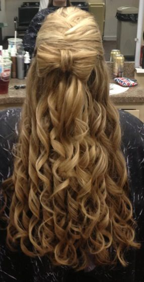 Bow in Hair with curls.