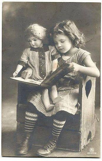Girl reading book with doll / source: FinnCamera on Flickr