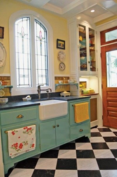 Vintage kitchen style, black/white checkered floors, leaded window, farm sink, painted cabinets, cool old wood door with window: