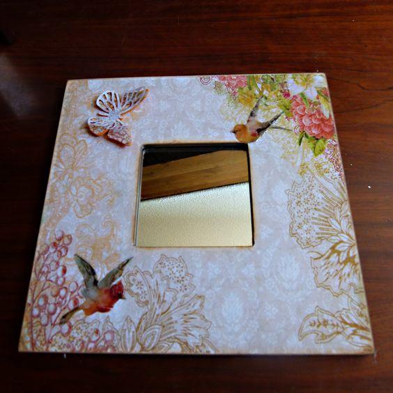 Espejo de malma decorado con papel de scrapbook, mariposa troquelada en goma eva y papel y con glosstit accentpara dar volumen a ciertas flores.