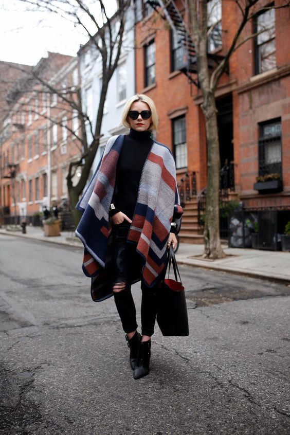 Blair Eadie: blanket poncho wrap, black ripped jeans #stripe #boots: