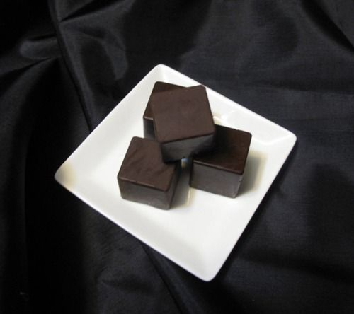 Dark Chocolate Cube Truffles Filled With Lavender and Black Pepper White Chocolate.