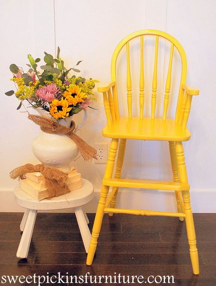 Vintage wood highchair antiqued or painted a bright accent color can add charm to your decor.