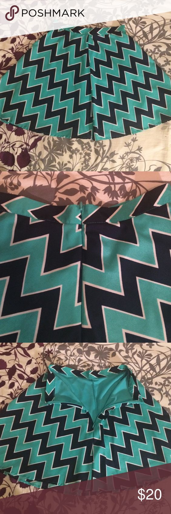Francesca's teal and navy skirt Bought at Francesca's Collection but brand is Buttons. Teal and navy chevron patterned high waisted skirt. Never worn! Half zip in back. Skirt and lining are both 100% polyester. Francesca's Collections Skirts Midi