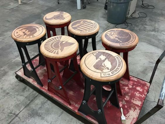 A Frame Stools with an etched custom design on mahogany seats by Vintage Industrial Furniture
