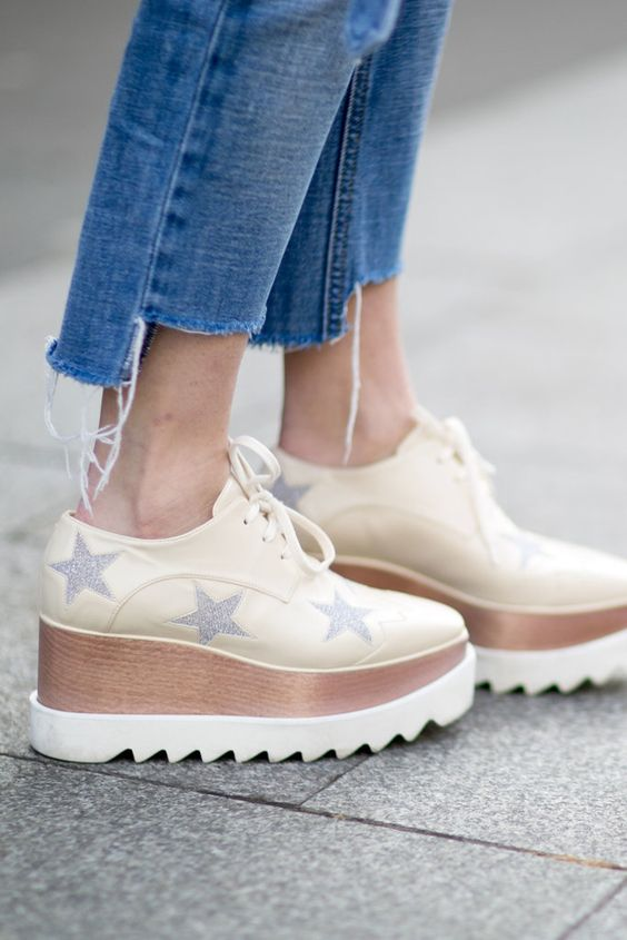 Platform shoes paired with cropped jeans.: