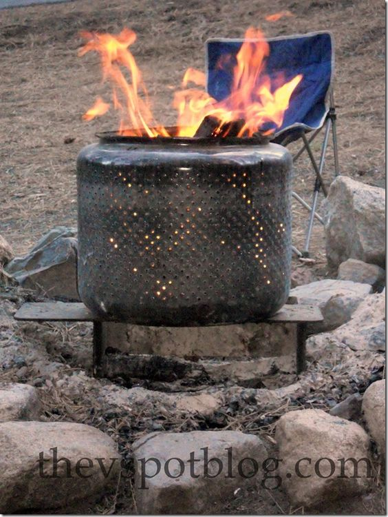 A used washing machine drum as a fire pit.