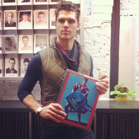 Brian Schimansky holding his Versace Eros campaign. #Inception