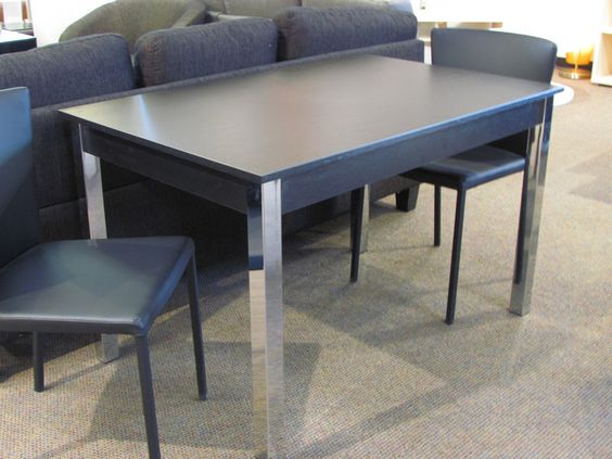 Zoom dining table in black woodgrain w/ chrome legs.  Was $499 Now $299