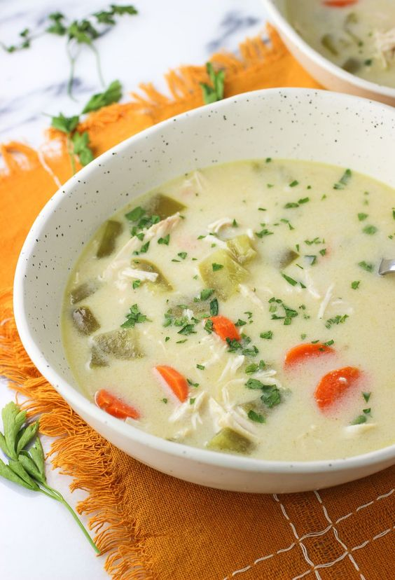 Slow cooker coconut curry chicken soup is a Thai-inspired chicken soup recipe with green curry paste, coconut milk, and chicken. An easy crock pot meal.