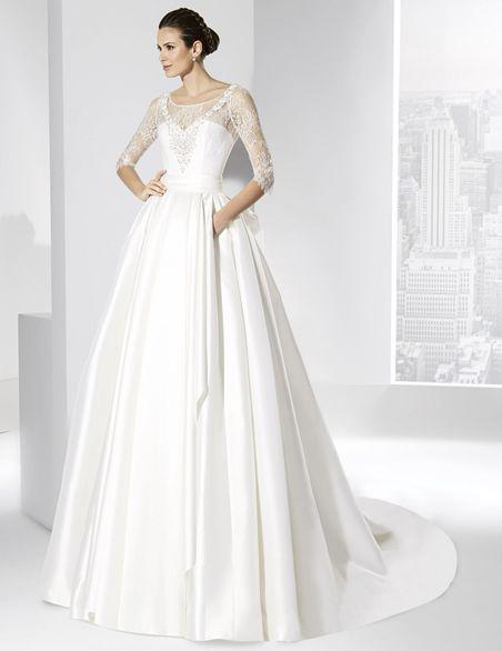 Vestidos de novia línea princesa en Mikado francés y cuerpo de Chantilly.
