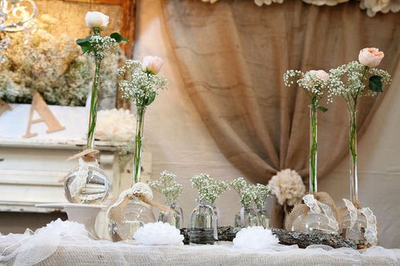 No tutorial, but the burlap and lace tied together around the vases is delightful--a contrast but so perfect together.  Notice the draping of burlap in the background--so many possibilities.