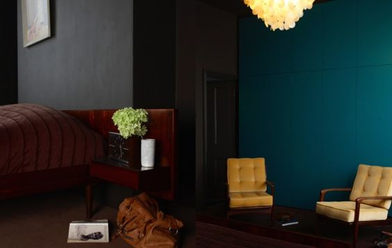 cushions w/ faux buttons Teal Paint and Yellow Chair in Location 78 Black-Walled Moody House in London | Remodelista