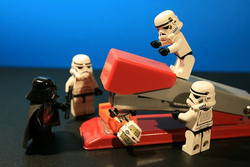 So we have had Lego Men doing rude things and acting like tribute bands. Now, we have Lego Men torturing people with desk stapler. At least it was not a Staple Gun! On that note and if you are looking to do this to a Lego Man we would suggest maybe using a Staple Gun like this one http://www.youtube.com/watch?v=1xT2kbZ1zc8 and you can buy a similar one in the photo for around 20.00 bucks. It's called the Rexel 603012.