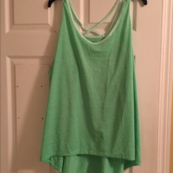 Workout shirt NWOT Workout shirt. New without tags. Purchased wrong size but took tags off before I knew what size it was. Couldn't return  Old Navy Tops Tank Tops