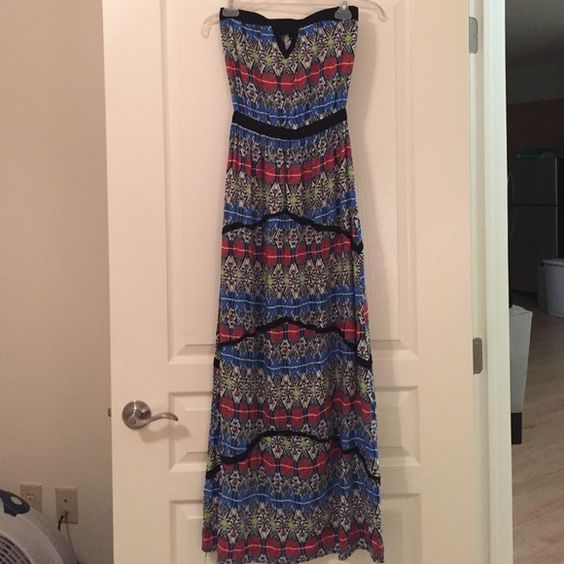 Strapless Boho Maxi Elastic at waist and top, peek a boo triangle on chest, lightweight 100% Rayon. Make an offer! Free People Dresses Maxi