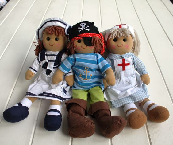 Character Rag Doll  Lovely character rag dolls. These charming rag dolls make a super special first gift for both boys and girls. We can personalise them with a luggage tag with the child's name on. They are stunning character representations of a nurse, pirate and sailor girl. We have been arguing over which one we prefer and we just still cannot decide.