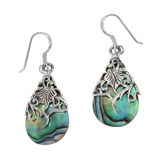 A floral vine of sterling silver en-wraps a teardrop shaped shell in this design. These earrings are a perfect addition for a vintage yet fashionab...