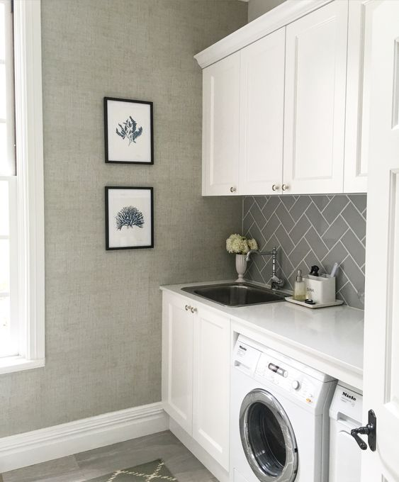 Laundry - Thibaut raffia wallpaper, grey subway tiles, grey stone floor tiles, caesarstone bench top, cabinets in Dulux Vivid White by Melinda Hartwright Interiors: