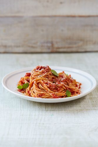 This classic tomato spaghetti recipe from Jamie Oliver's Food Revolution Collection is a fantastic, nutritious mid-week meal. Once you've made this a few times you can add other simple ingredients, such as baby spinach, chopped rocket leaves, or fresh or frozen peas, to your basic tomato sauce to completely transform it.