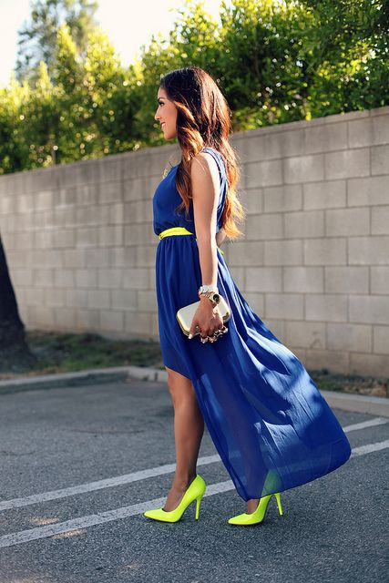 Love the mix of neon accessories with the asymmetrical hem.