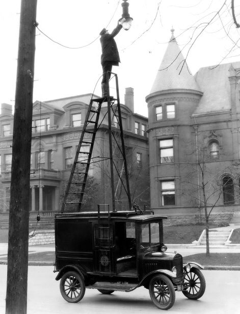 "Changing street                                                lamps 1910's style.                                                ""WOW"":"