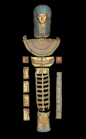 Gilt cartonnage mummy mask and trappings. Ptolemaic Period. c. 305-30 B.C.