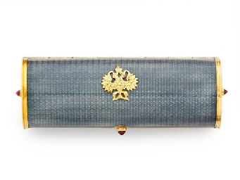 A SILVER-GILT AND GUILLOCHÉ ENAMEL CIGARETTE CASE  WITH SPURIOUS MARKS FOR FABERGÉ  Tubular, the cover, sides and base each with grey guilloché enamel, the thumbpiece and each end set with a cabochon ruby, the cover applied with an Imperial eagle, marked inside base  3½ in. (89 mm.) long
