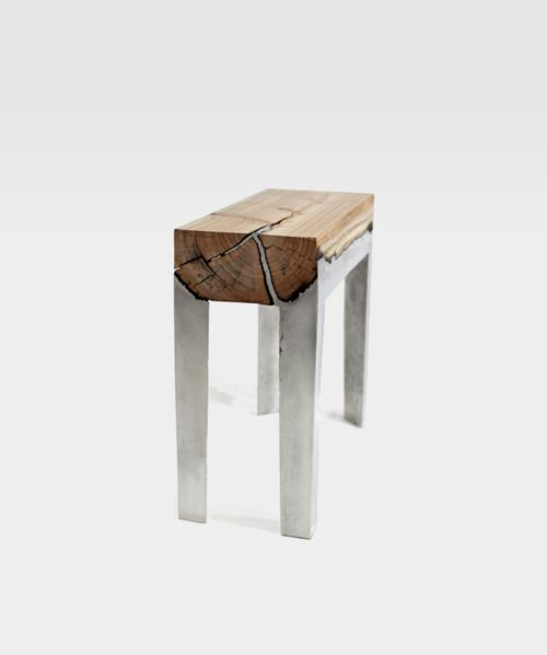 themissive:    Wood Casting by Hilla Shamia, 2011    Furniture combining cast aluminium and wood. The negative factor of burnt wood is transformed into aesthetic and emotional value by preservation of the natural form of the tree trunk, within explicit boundaries. The general, squared form intensifies the artificial feeling, and at the same time keeps the memory of the material.