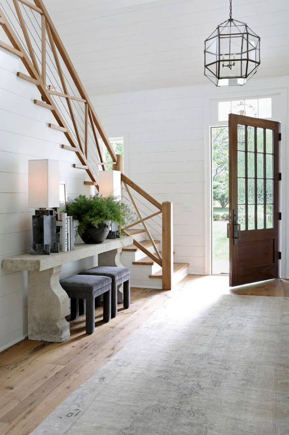 Farmhouse entry and staircase with shiplap and rustic architectural elements. Rachel Halvorson Inspired Decorating Tips. #interiordesign #farmhouse #staircase #shiplap #frontdoor