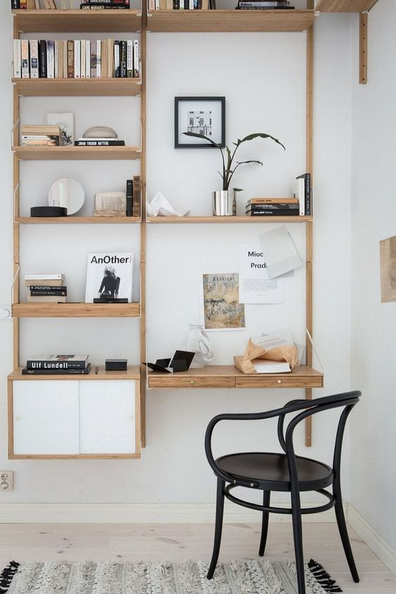 The IKEA Svalnas shelving system with desk and cupboard storage is made from sustainable bamboo and can be configured to suit your workspace #wallmounteddesks #svalnas #ikea #shelfsystem #officestorage #officeshelves #workspaces #workfromhome #officedesign