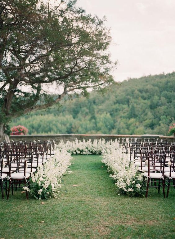 the dreamiest ceremony ever with white rose petals along both sides of the aisle and a circle altar around the bride and groom, done with greenery #weddingceremony #aisle #floraldesign #ceremony #weddingideas #tuscanwedding #tuscanywedding #tuscany