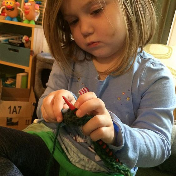 She's knitting!!! She wants to knit a scarf for Grandma Barb. She can do about…