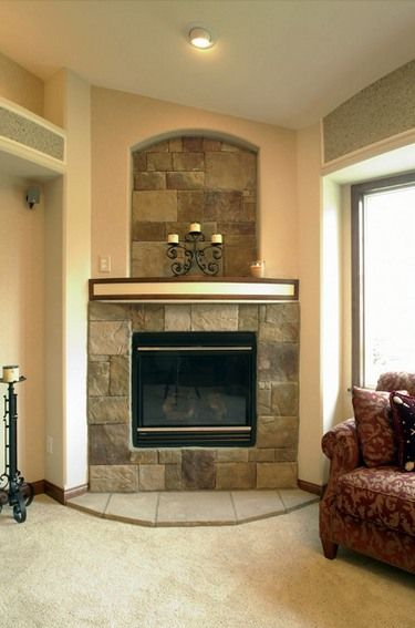 The corner fireplace design ideas featured here come in a Corner rock fireplace designs