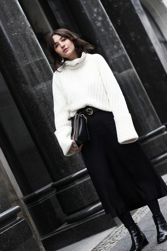 Oversized sweater & black midi skirt:
